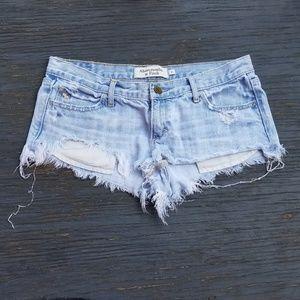 Distressed Raw Hem Light Wash Denim Mini Shorts